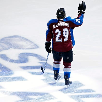 Apr 26, 2014; Denver, CO, USA; Colorado Avalanche forward Nathan MacKinnon (29) waves to the crowd after game five of the first round of the 2014 Stanley Cup Playoffs against the Minnesota Wild  at Pepsi Center. The Avalanche won 4-3 in overtime.  Mandatory Credit: Chris Humphreys-USA TODAY Sports