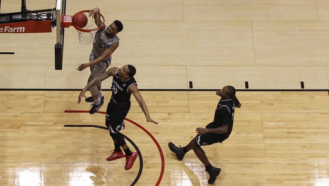 Xavier Musketeers guard Trevon Bluiett (5) dunks in the first half during the 84th annual Skyline Chili Crosstown Shootout basketball game between the Xavier Musketeers and the Cincinnati Bearcats, Thursday, Jan. 26, 2017, at Fifth Third Arena in Cincinnati.