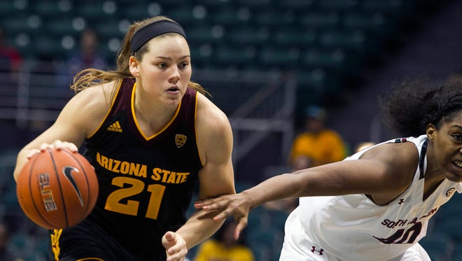 Arizona State forward Sophie Brunner, left, dribbles past South Carolina forward Jatarie White during the first half of an NCAA college basketball game, Friday, Nov. 27, 2015 in Honolulu.