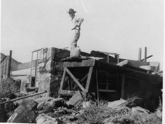 Carpenter during construction of a rock house.