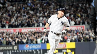 Todd Frazier gets ready to round third base after hitting a three-run  home run in the second inning of Game 3, Monday, October 16, 2017.