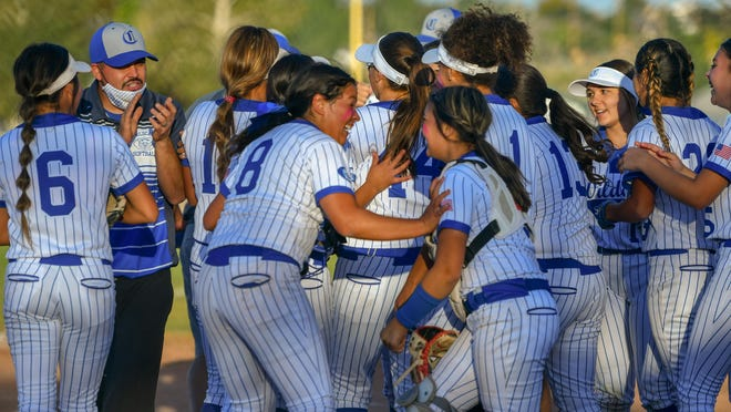 The Pueblo Central High School softball celebrates winning the South-Central League title with a 4-1 win over Pueblo West on Thursday, Oct. 1, 2020, at Pueblo West High School.