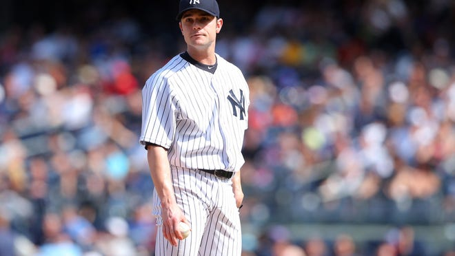 Yankees relief pitcher David Robertson reacts after blowing a save against the Twins in the ninth inning Sunday at Yankee Stadium.