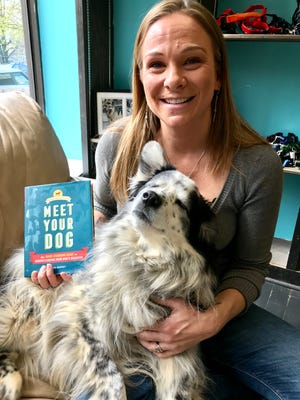 """Author Kim Brophey with one of her three dogs, Rocky. Brophey thinks her new book, """"Meet Your Dog,"""" will shake up the dog training world."""