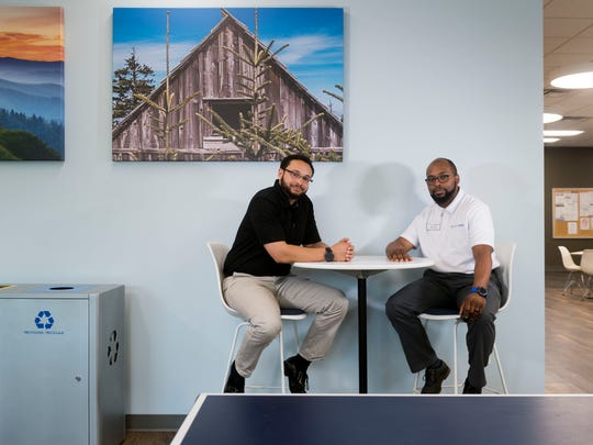 Brandon Hodges, left, U.S. Cellular Leader in customer service and technical support, stresses the opportunities the company offers. That was true for Devon Kirton, retail sales, who always loved technology and was encouraged by U.S. Cellular employees to apply for a job there.