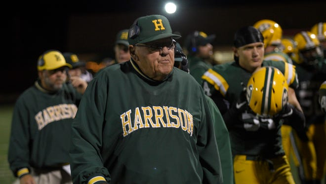 Harrison coach John Herrington needs just three wins to tie Al Fracassa for most wins by a high school football coach in Michigan.