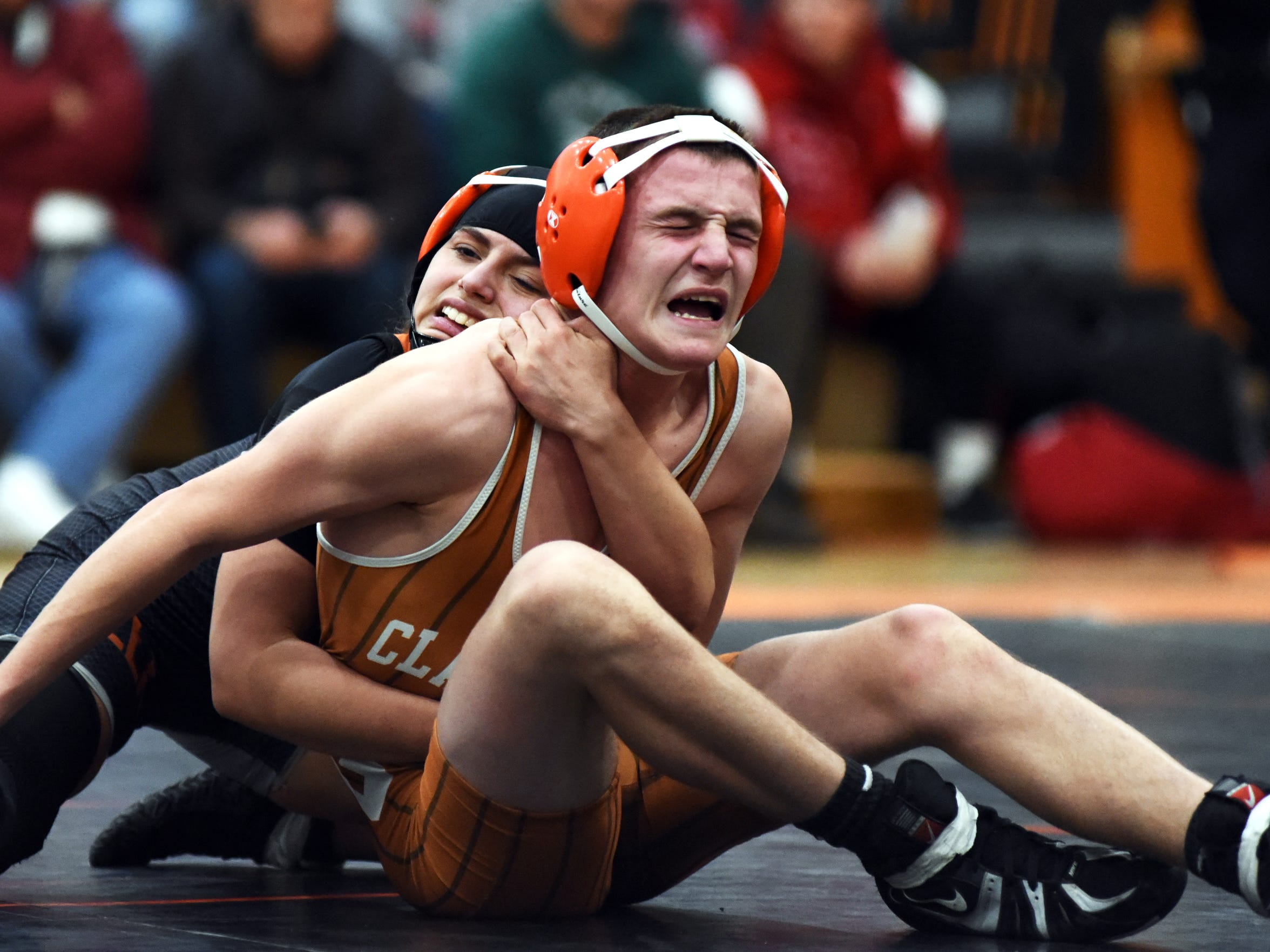 Claymont's Grant Stewart writhes in pain while being