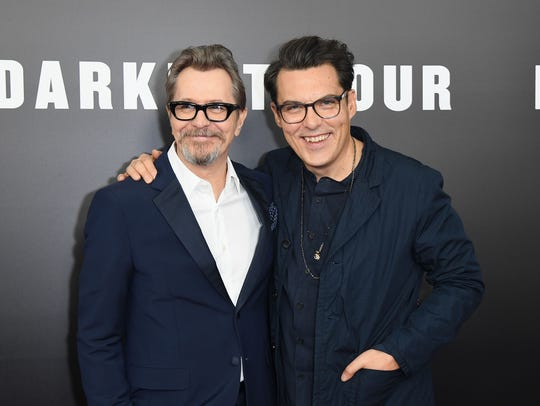 Gary Oldman (left) and director Joe Wright attend the