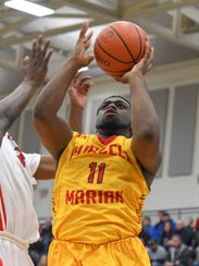 Javonta Lyons of Purcell Marian shoots the ball in
