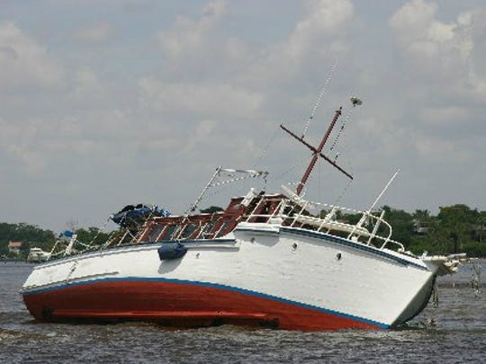 An unnamed wooden-hulled derelict vessel ran aground in August 2008 near the Crossroads and broke apart until floating chunks of the hull nearly killed boaters who collided with the parts. (FILE PHOTO)
