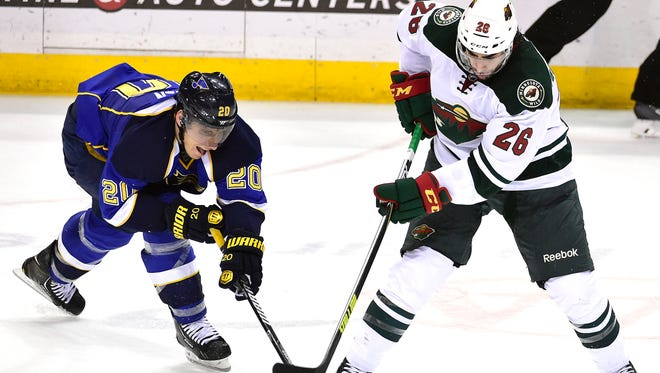 St. Louis Blues left wing Alexander Steen (20) pokes the puck from Minnesota Wild left wing Matt Moulson (26) during the third period at Scottrade Center.