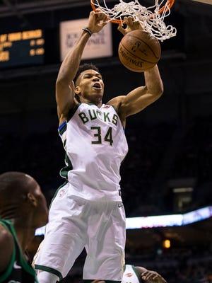 Milwaukee Bucks forward Giannis Antetokounmpo dunks during the first quarter against the Boston Celtics in Game 4.