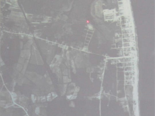 Using satellite images, Town Manager Cliff Graviet pointed out where some of the flooding in Bethany Beach occurs.