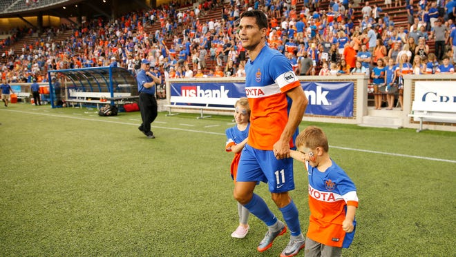FC Cincinnati striker Danni Konig (11) takes his children on the field after the team's 2-0 win against Saint Louis FC on June 24, 2017 at Nippert Stadium in Cincinnati.