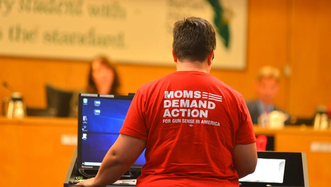 Megan Paauwe addresses the school  board speaking against guns in school at the school board meeting Tuesday night during the discussion of the Marjory Stoneman Douglas High School Public Safety Act.