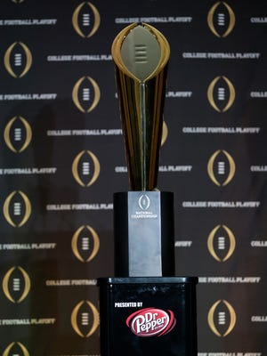 College football playoff championship trophy is displayed during the College Football Playoff Selection Sunday event at the Gaylord Texan resort.