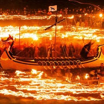 People dressed in traditional costumes circle a replica Viking longship with flaming torches during the Up Helly Aa Viking Festival on Jan. 27 in Lerwick on the Shetland Isles, England.