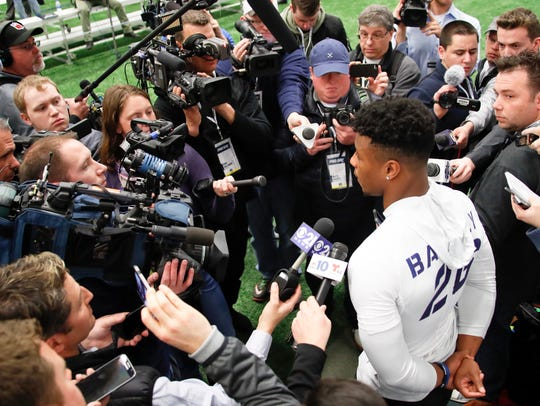 Penn State running back Saquon Barkley (26) is surrounded