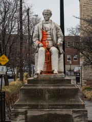 The statue of George Dennison Prentice covered with orange paint.