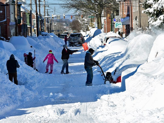 People dig out in Chambersburg. Pa.