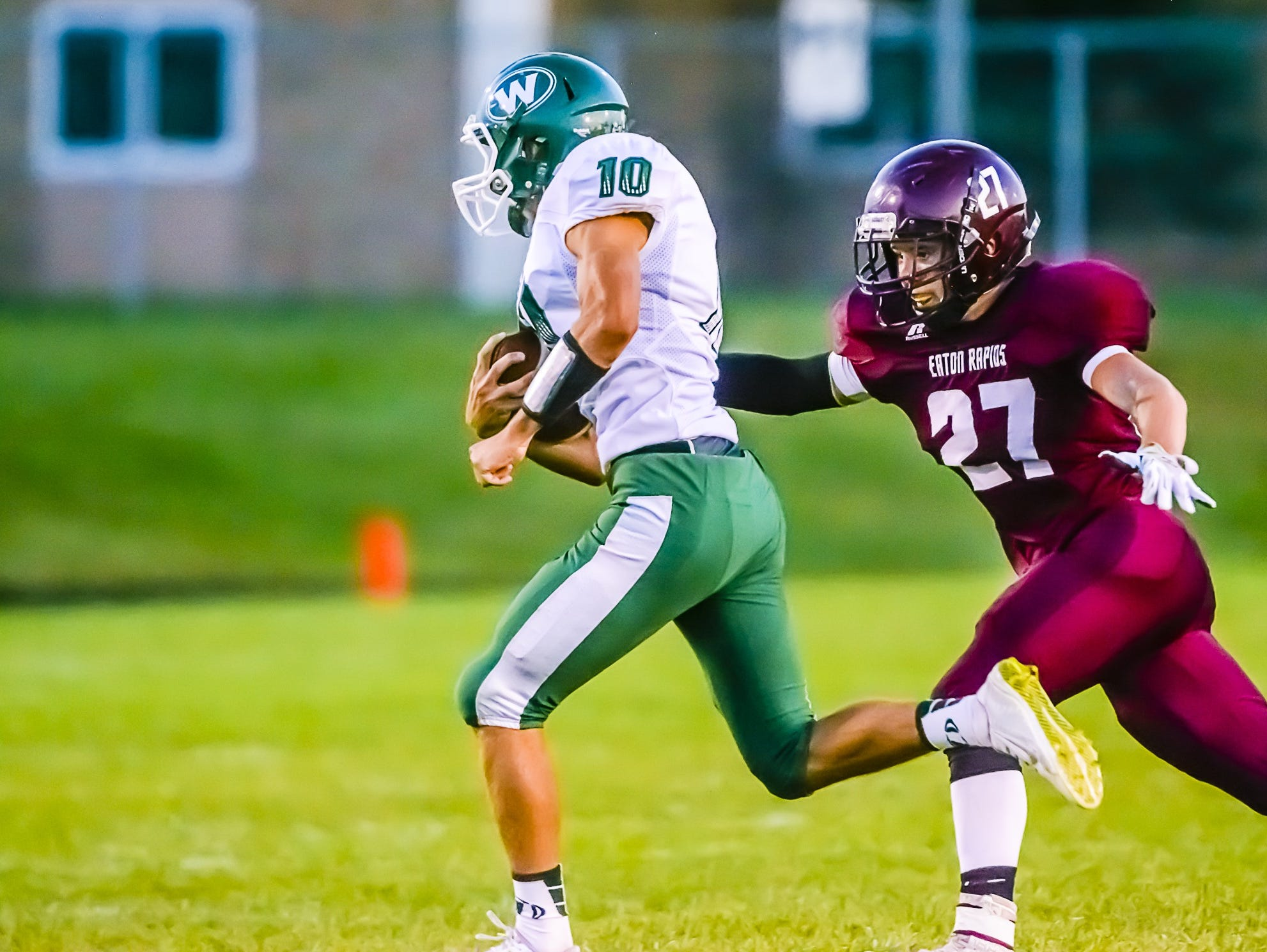 Logan Fenech,10, of Williamston, tries to turn the corner during the Hornets' game against Eaton Rapids last season. Fenech is one of four returning starters for Williamston's offense in 2016.