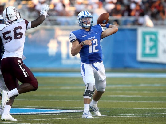 MTSU's quarterback Brent Stockstill (12) passes the