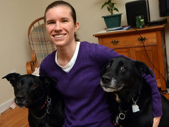 After suffering a brain injury while playing rugby in 2010, Jennifer Hindley of Springettsbury Township, shown with her dogs Nala, left, and Simba, is graduating from York College. Thursday, May 11, 2017.  John A. Pavoncello photo