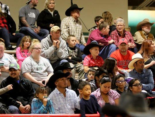 Bull riding fans watch the show Saturday, Nov. 11,