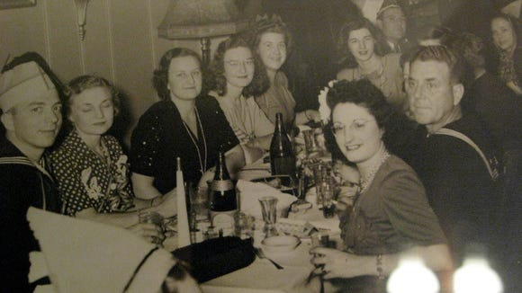 Reader Steve Kohler shared this photo in early 2016, trying to find out more information. He believed it to be taken during the mid-1940s. 'It could be a New Year's Eve party or celebrating the end of World War II,' he noted. 'The photos are taken in a bar/night club somewhere in York.'