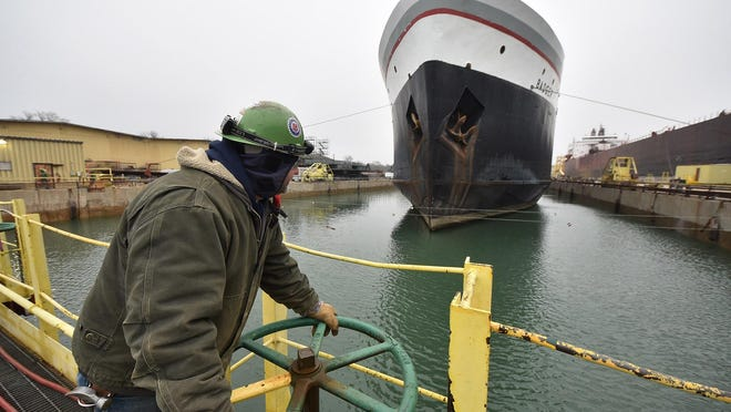 Marty Mueller of Forestville is among Bay Shipbuilding Co. crew keeping a watchful eye on the lowering of the car ferry S.S. Badger in dry dock on Monday, Dec. 7, 2015. The crew uses center lines stretching parallel above the waterline as well as plumb lines in the precision placement. It takes about eight hours to remove the water from the dry dock where the Badger will undergo routine inspection.