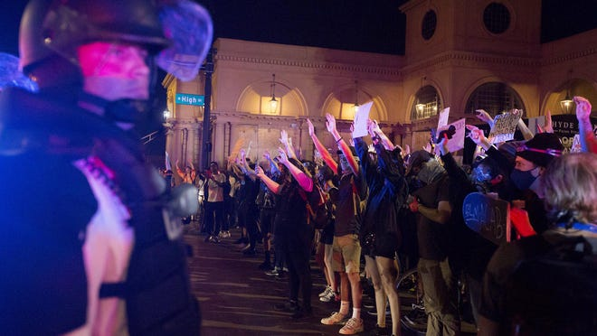 Protesters are met by police as they try to march north on High Street after a 10 p.m. curfew this summer. Protesters have continued to come Downtown nightly for nearly a month, since the death of George Floyd in Minneapolis.