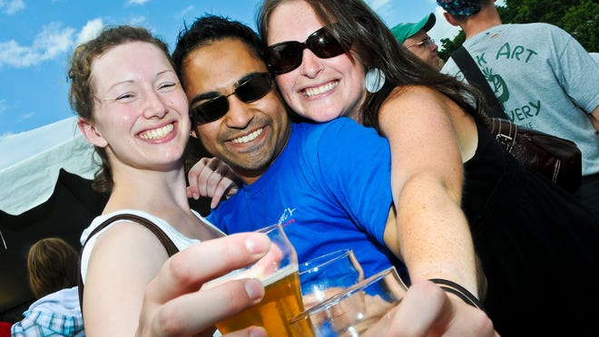 (From left) Megan Estey, Arshad Hasan, and Emily Halnon, all of Burlington at the 2009 Vermont Brewers Festival.