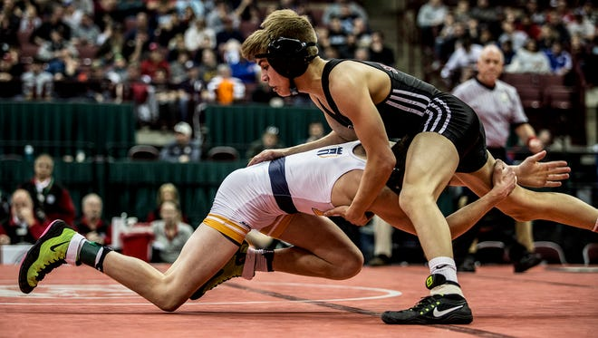 Oscar Sanchez of Genoa won the state championship against Wyatt Riddle of Legacy Christian in the 106 weight class.