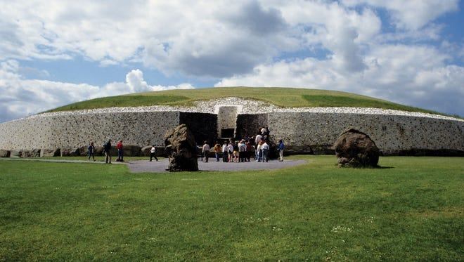 Newgrange's facade is a mosaic of white quartz and dark granite. Above the doorway is a square window, which plays a key role illuminating the sacred chamber during the winter solstice.