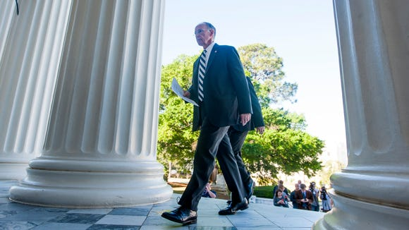 Governor Robert Bentley walks into the capitol building following a news conference on the capitol steps in Montgomery, Ala., on Friday April 7, 2017.
