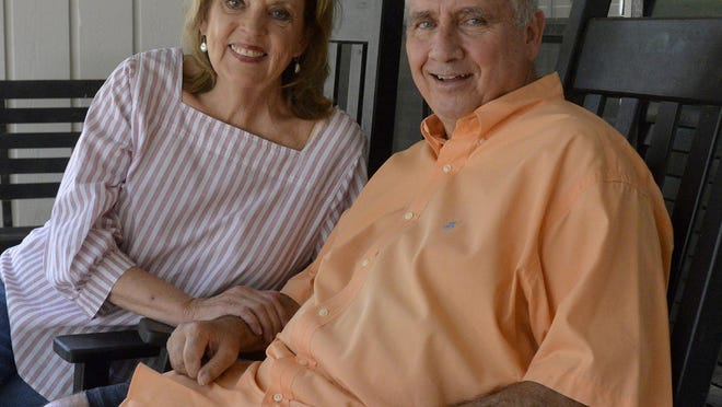 Marion and Mark Thomas sit on their front porch on July 22 in Savannah.