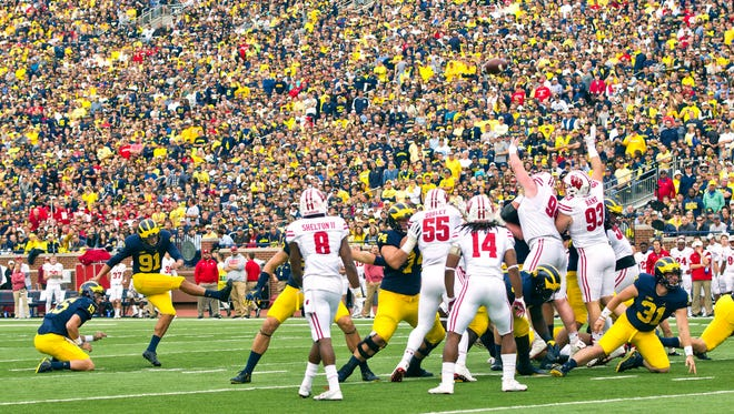 Michigan kicker Kenny Allen (91) attempts a field goal in the second quarter of an NCAA college football game against Wisconsin at Michigan Stadium in Ann Arbor, Mich., Saturday, Oct. 1, 2016. Allen missed two attempts in the first half. (AP Photo/Tony Ding)