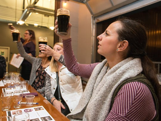 """Stephanie Bolin (right) is taught to look for """"ASTM"""" which stands for Appearance, Smell, Taste and Mouth feel, during a beer class taught by Dee Gedlen with MKE Beer Geek on winter beers, at the new Third Space Brewing on Nov. 17, 2016."""