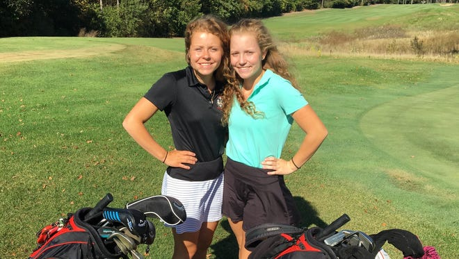 Reece (left) and Olivia Ohmer, two sisters who are Type 1 diabetics, led Pinckney to the SEC White golf championship.