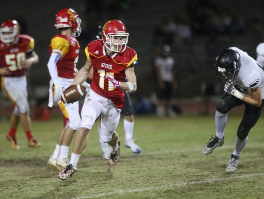 Palm Desert's Brooks Stephenson runs against Saddleback