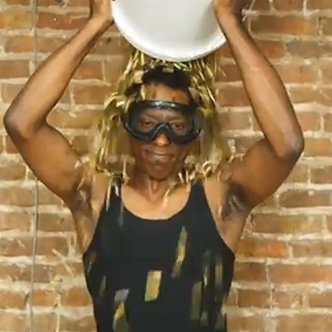 Orlando Jones uses a bucket of bullet casings for his ALS challenge.
