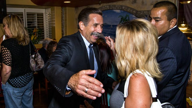 Glendale mayoral candidate Mark Burdick greets supporter Julie Frisoni  at his election night party at  Manuel's Mexican Restaurant in Glendale on Aug. 29.