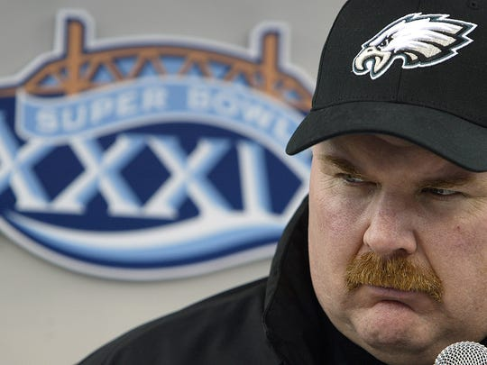 Philadelphia Eagles coach Andy Reid talks with reporters at Alltel Stadium in Jacksonville, Florida on Feb. 1, 2005.