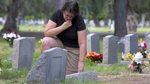 Nicole Hayes visits the gravesite of her infant daughter, Samantha, at the Mesa Cemetery on July 1, 2016. Hayes lives in Gilbert and is a strong supporter of a Gilbert cemetery so residents don't have to travel to other cities unless they want to.