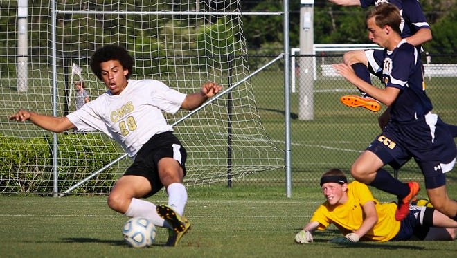Central Magnet's Zavior Phillips scores a goal during the Tigers' win over Chattanooga Christian.