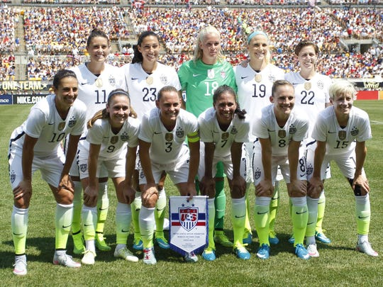 The USA's starting 11, including goalkeeper Ashlyn Harris, center back in green, pose for a photo before Sunday's 8-0 win against Costa Rica.