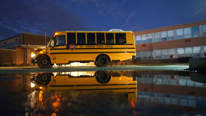 A school bus sits outside of Christiana High School after dropping off students at 6:35 a.m. January, 2017.