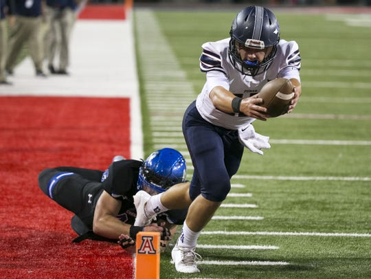 Perry quarterback Brock Purdy scores a touchdown against Chandler in Saturday's 6A title game.
