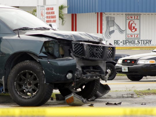 Officers and medics work to clear the scene of a two-vehicle