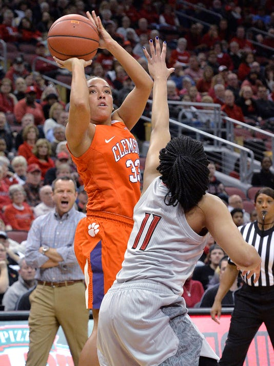 Clemson guard Alexis Carter (33) shoots over Louisville guard Arica Carter (11) during the first half of an NCAA college basketball game Wednesday, Feb. 7, 2018, in Louisville, Ky. (AP Photo/Timothy D. Easley)